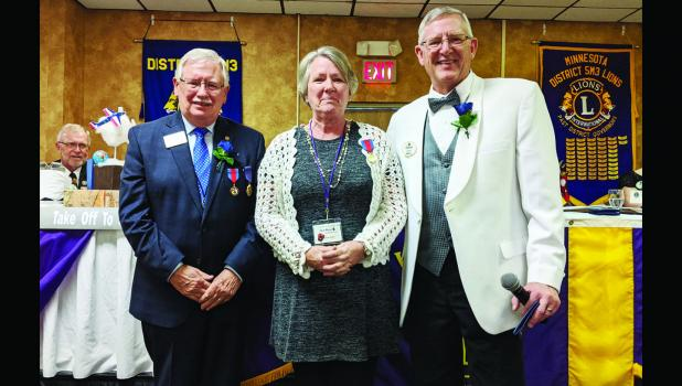 Deb Rasset was presented the third highest honor in Lionism. She is pictured with Lions Clubs International Director Larry L. Edwards and 5M3 District Governor Don Kuehl.