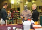 Elementary Principal Jeff Kuehn, School Board Member Justin Roiger, and Brown County Sheriff's Office Investigator Eric Schwarzrock prepare for the demonstration in the Media Center at Springfield Public School.   All participants wore face masks to protect them from pellets.