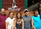 FFA Advisor T.J. Brown, Bella Johnson, Cylee Gaff, Jerry Majors and Kory Schenk posed for a picture at the Clydesdales Stable at Grant Farms.