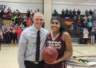 Girls Basketball Head Coach Brandon Wilhelmi congratulations Vishe Rabb on her 1000th point.