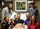 The Kaseforth family spent Thanksgiving Day with Johnny at St. Mary's Hospital in Rochester.  Pictured with Johnny are his sister and brother-in-law, Allison and Josh Nachreiner, and their son, Ian, at the left; and his parents, John and Roseanne Kaseforth, and his brother, Joseph, at the right.