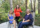 Simone Rasmussen, left, is happy to be a part of the Springfield community as a student from Denmark and living with the Martin and Mary Larson family.  Simone is pictured with Marah and Mary Larson on the patio at the Larson farm.