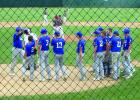 Congratulations for Mitchell Leonard as he crosses home plate after a home run.
