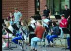 Members of the high school band playing Bohemian Rhapsody.